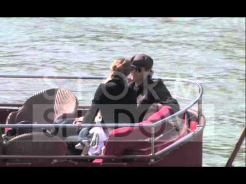 In love Tom Brady and Gisele Bundschen and baby on a boat in Paris