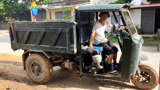 excavator and dump truck at work. Công nông 3 bánh