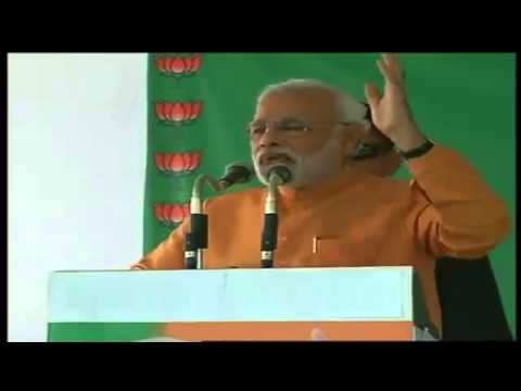 BJP PM candidate Narendra Modi addressing poll campaign rally at Alwar in Rajasthan