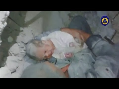 A baby is rescued from rubble in the northern Syrian city of Aleppo