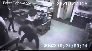 A ninja women takes out 3 guys in a restuarant