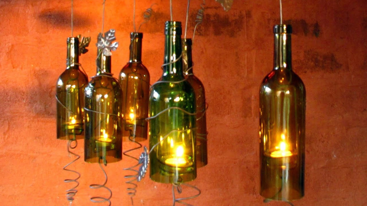 Recycled wine bottles made into a hurricane candle holder for Easy way to cut wine bottles