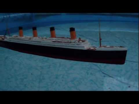 RMS Titanic Model Floating at Dusk
