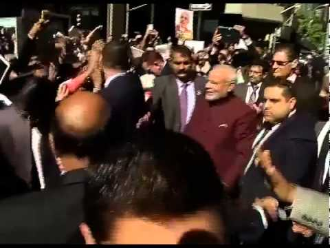 PM Narendra Modi comes out to greet Indians outside hotel