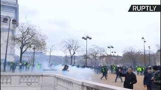 Tear gas & Water cannons: Yellow Vest protest in Paris turns violent