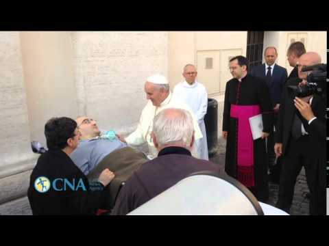 Pope Francis greets paralyzed man who risked all to see him