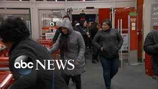Shoppers wait in lines for Black Friday deals