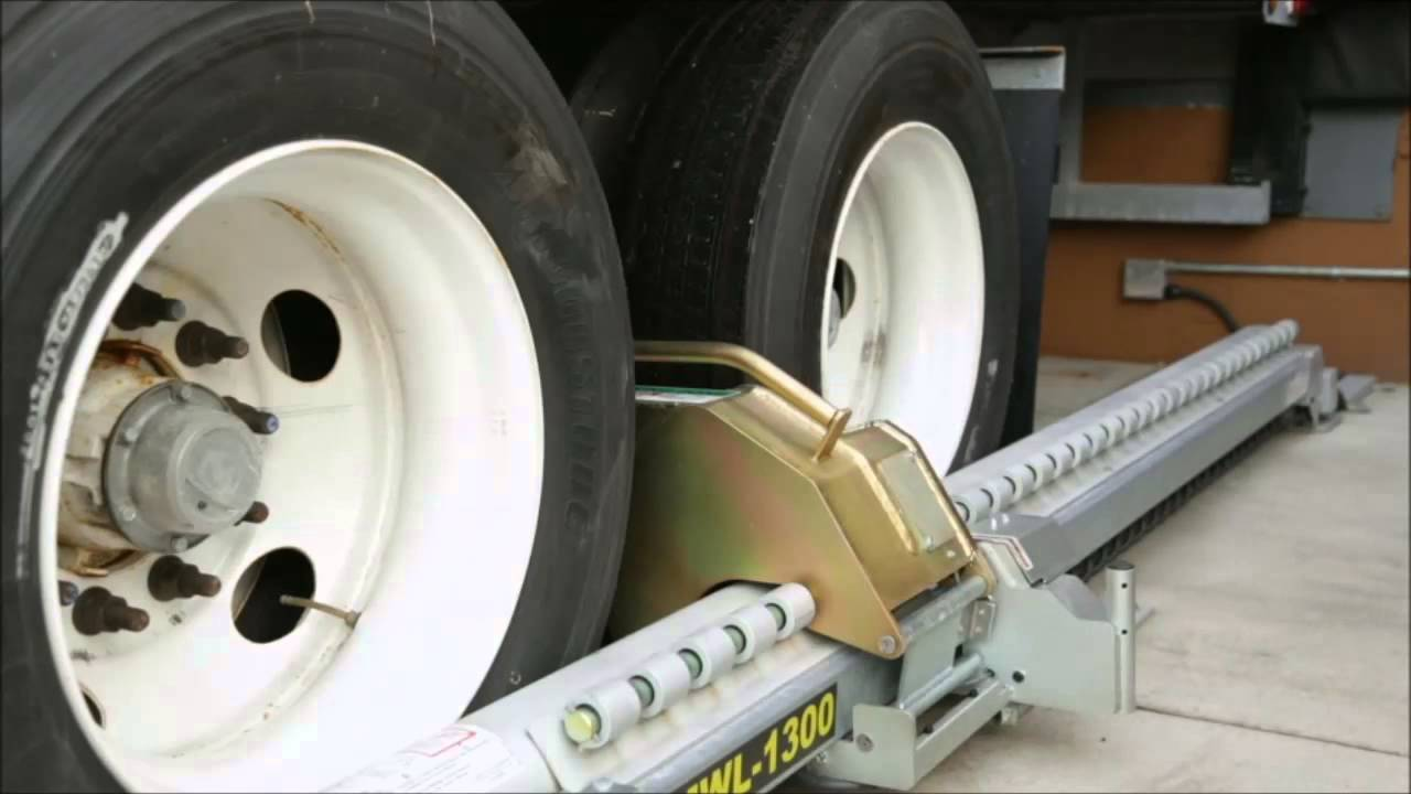 dok lok Rite-hite rhr-1000 dok-lok owner'smanual 5 definition and function the rhr-1000 dok-lokvehicle restraint is an electro- mechanical, self-aligning restraint device used to secure trucks.