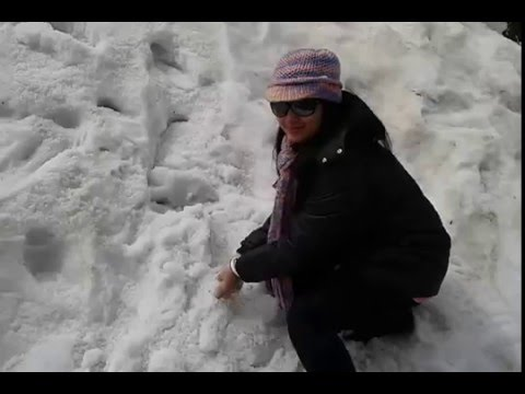 Snowfall at Changu Lake - Wife playing with Ice at Tsomgo Lake, Sikkim