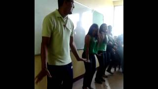 Teacher dances to his students.
