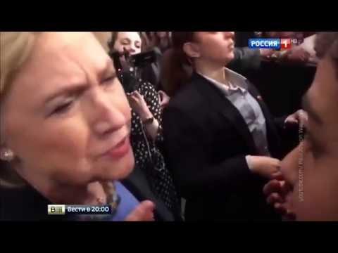 Рядом с Хилари Клинтон дежурит человек со шприцем.