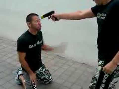Krav Maga Gun to the head while kneeling defense Image 1