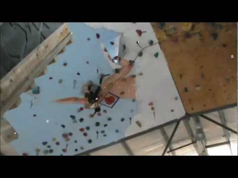 Angie 7 year old rock climber , climbing roof in Canberra gym