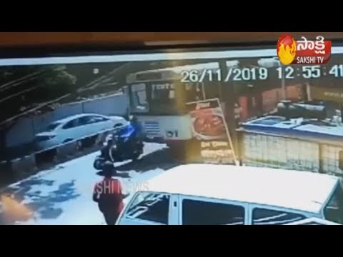 Woman dies in a road accident at Banjara Hills |  CCTV Footage | Sakshi TV
