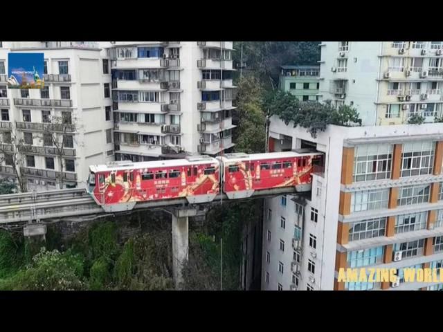 Chinese train that goes THROUGH a block of flats : Astonishing video : Chongqing Mountain City