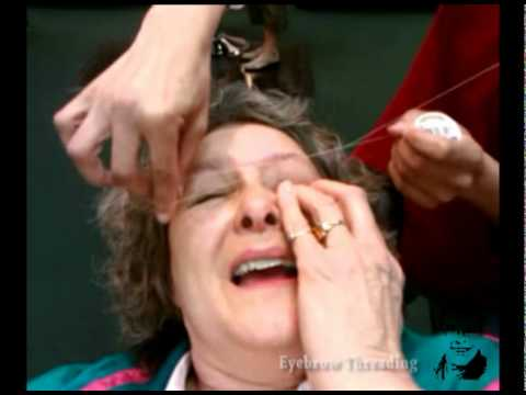 Eyebrow threading is PAINFUL. but funny to watch!