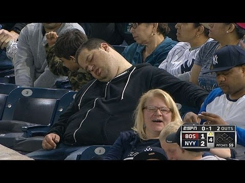 Fan sleeps in stands during game vs. Red Sox