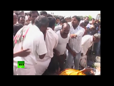 RAW: Chaos after Indian train collides with school bus killing at least 19 children