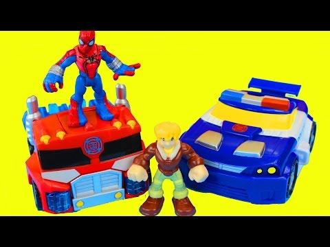 Transformers Rescue Bots Optimus Prime And Spider-man Battle Imaginext Dinosaur Playskool video