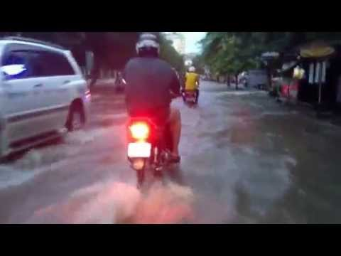 driving on flooded roads in Phnom Penh after rain yesterday