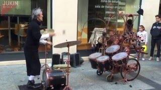 Juggling drummer street performer
