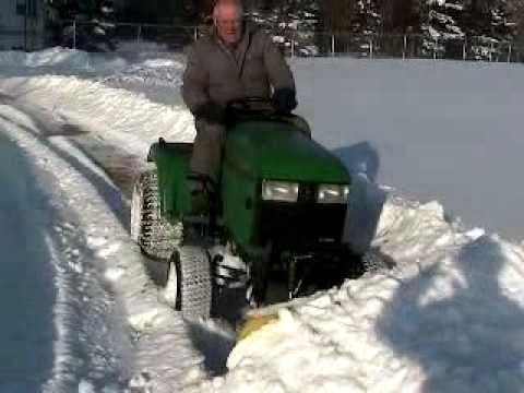 John Deere 445 pushing snow for stlouissux9119