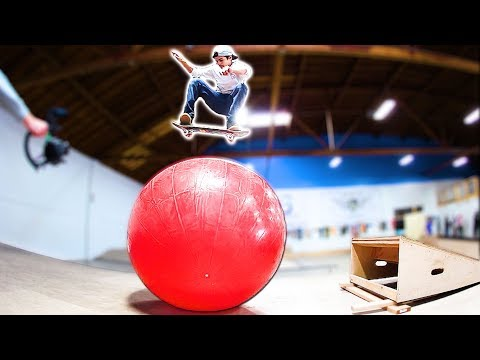 KICKFLIPPING OVER THE WORLD'S BIGGEST BOUNCY BALL!