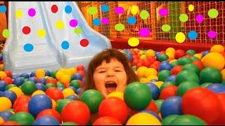 kids play on the playground with balls and slide