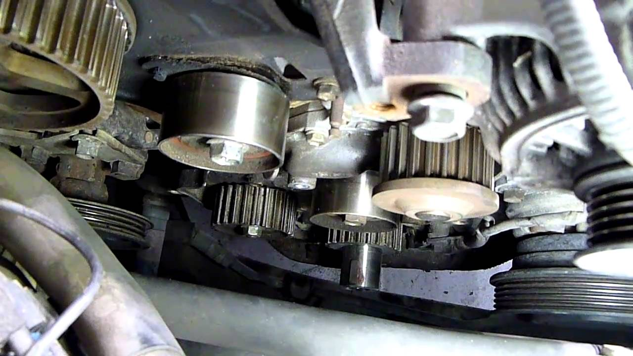 512352 Torque Spec Idler Pulley Belt Tensioner as well Watch as well Watch as well RepairGuideContent in addition RepairGuideContent. on toyota corolla water pump replacement