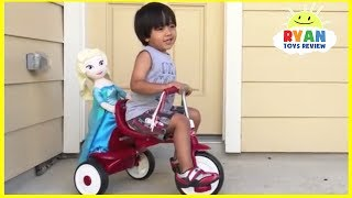Ryan rides on a bike and play with Disney toys!