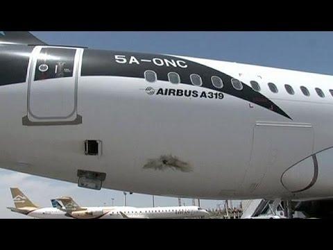 Libya warns militias over Tripoli airport attacks