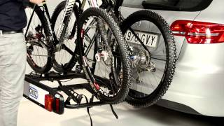 Видео: Велокрепление на фаркоп Cruz Cyclone.Для 2/3 велосипедов, с откидным ручным механизмом и замком для фаркопа и каждого велосипеда.