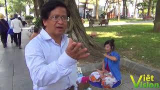 Du khách Mỹ gốc Việt bị sốc khi chứng kiến học viên Pháp Luân Công hành pháp tại vườn hoa Lý Thái Tổ