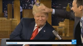 US - Trump becomes the 1st candidate to get his hair ruffled on TV on Jimmy Fallon's Tonight Show