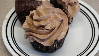 Chocolate Swiss Meringue Buttercream Frosting (on pudding filled chocolate cupcakes)