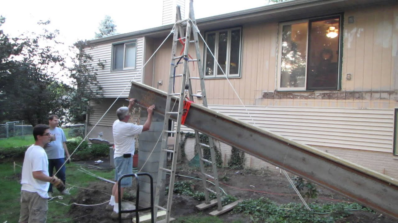 Using A Pulley System To Hoist A Big Steel Beam For A