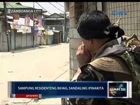 Saksi: Ilang Bihag Na Residente Sa Zamboanga City, Nagwagayway Ng Puting Tela video