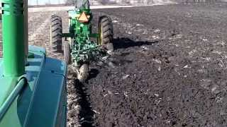 JD Model A Plowing behind a JD 720
