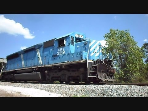 This is a video I made on Hwy 39 in Plant City Florida of a CEFX Locomotive #3129 backing a long freight by it's self into a phosphate plant named CF Industr...