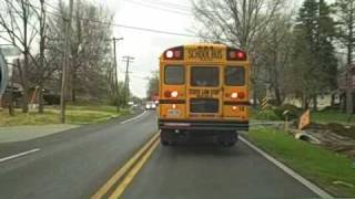 CAR BLOWS SCHOOL BUS STOP SIGN