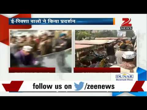 E-rickshaw drivers demonstrate outside Arvind Kejriwal's residence