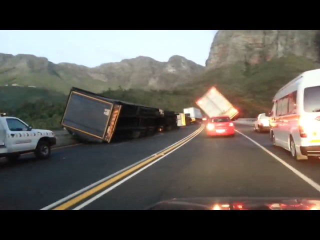Trucks blown over by strong wind - MUST WATCH