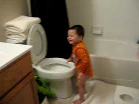 toddler dunks head in toilet