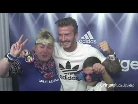 David Beckham surprises fans in photo booth at...