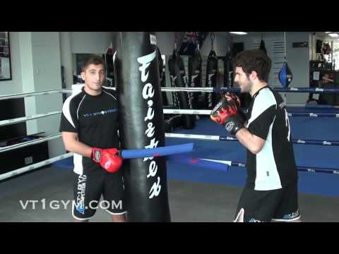 Muay Thai and MMA - Slip, Bob and Weave Drill w/ Heavy Bag and Batons Image 1
