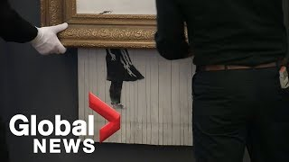 """Banksy's iconic """"shredded"""" art goes back on display in Germany"""