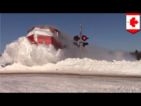 Snowpiercer: deep snow no problem for train in New Brunswick, Canada