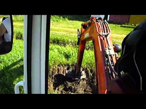 Digging a hole for weeds