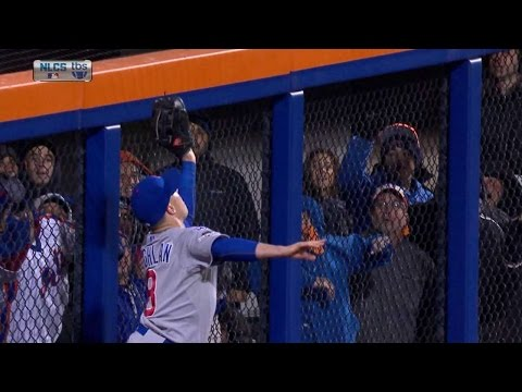 Coghlan leaps at the wall to rob Cespedes