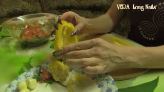 Long Nails in the kitchen making vegetable salad